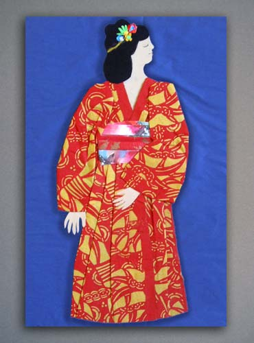 Folded and cut paper illustration of a Japanese doll.